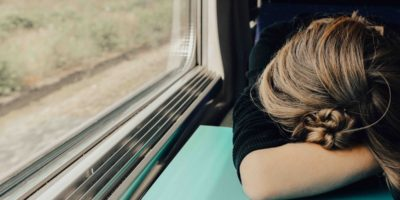 woman looking tired on a train